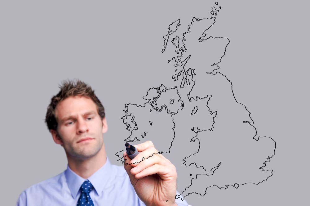 man drawing uk map